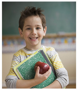 Child in school with apple